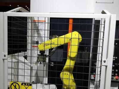 汽车喷油嘴端面磨床上下料机器人